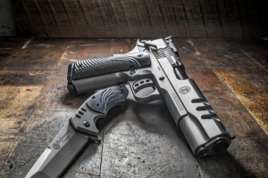 Battenfeld Technologies – Made In USA Giveaway – Win a prize that consists of one (1) Smith & Wesson 1911 ($1589) one (1) performance center knife ($149).