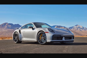 "Omaze – 2021 Porsche 911 Turbo S And $20000 – Win a 2021 Porsche 911 Turbo S and $20000 USD (the ""Grand Prize"")."