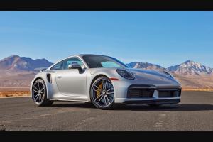 """Omaze – 2021 Porsche 911 Turbo S And $20000 – Win a 2021 Porsche 911 Turbo S and $20000 USD (the """"Grand Prize"""")."""